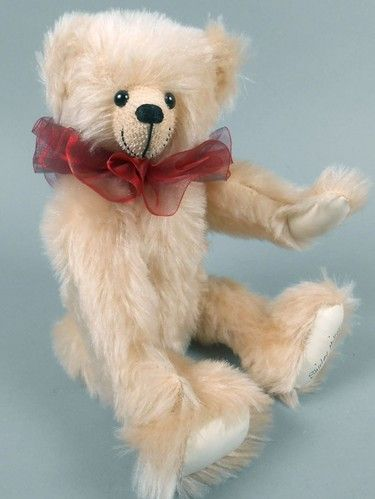 """Adopt a Bear todayMiller by: Shirley Miller 10.5"""" fully jointed mohair bear, poly/pellet stuffed. Sheer burgundy ribbon collar, signed on foot.  No tag."""