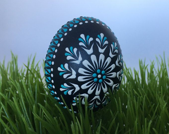 This is a chicken egg pysanka in white and purple, decorated with wax.  To create this egg, I use the pinhead method also known as the drop-and-pull pinhead method. In this method, mostly used in Poland, the Czech Republic, Slovenia, and Lithuania, a pin stylus is used as a tool. The head of the pin is dipped into hot wax and applied to the eggshell. There are two basic techniques used in this method - wax-embossed and wax-resist. This egg is wax-embossed, the wax persists on the eggshell…