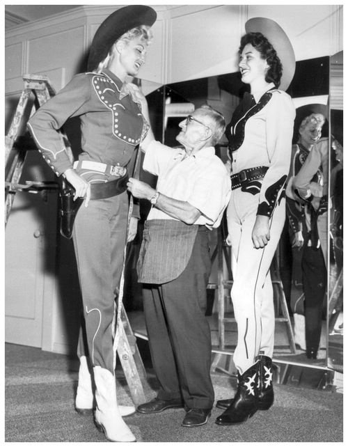 Cowgirls getting fitted by Nudie Cohn. P.S. - I want those black boots!