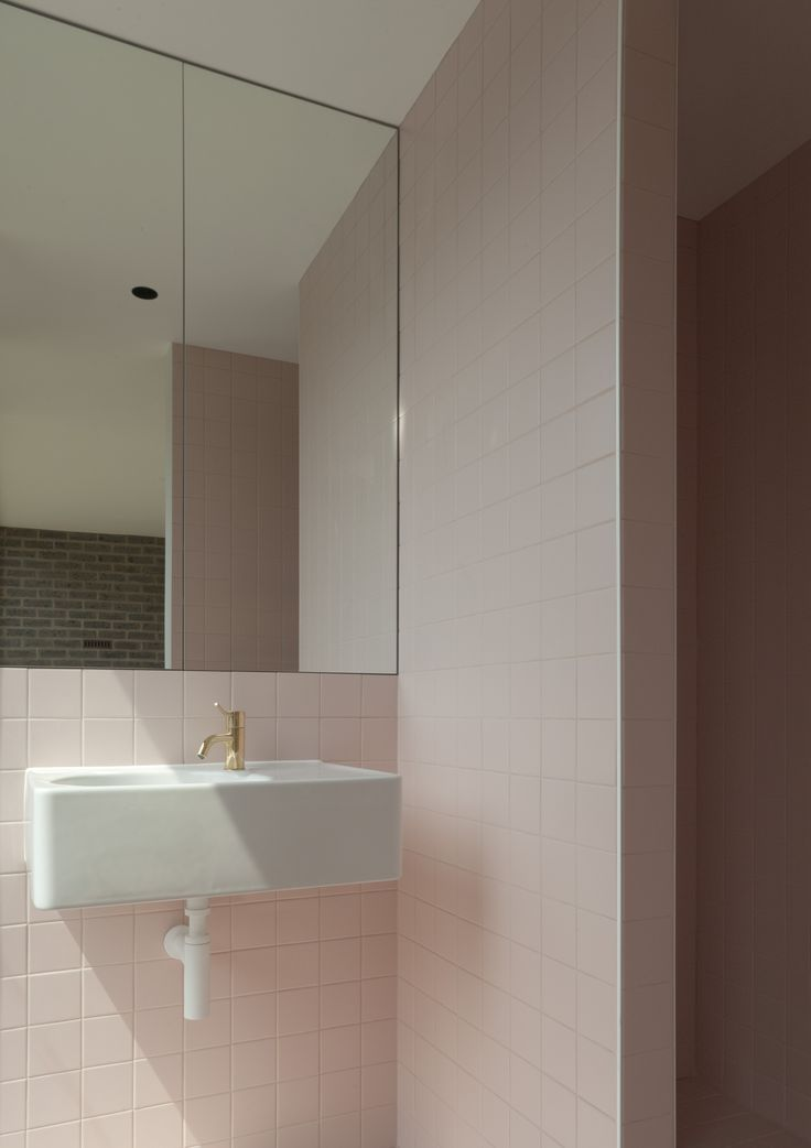 blush tiles white sink and gold tapware