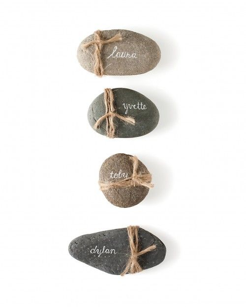 Knot some twine around flat stones for rustic place cards. (Use a white paint pen or gel ink pen to write guests' names in script for an elegant contrast.)