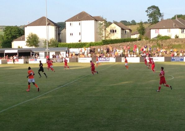 A Blackpool side made up mostly of trial players lost 3-1 against non-league side Kendal Town.