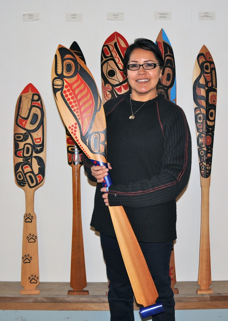 Front: Spawning Salmon by Roberta Quock.  Left: Wolf Paddle by Stacy Calder. Right: Paddle by Lyle Quock Jr. #NWCCBC #Aboriginal #Art #FirstNations