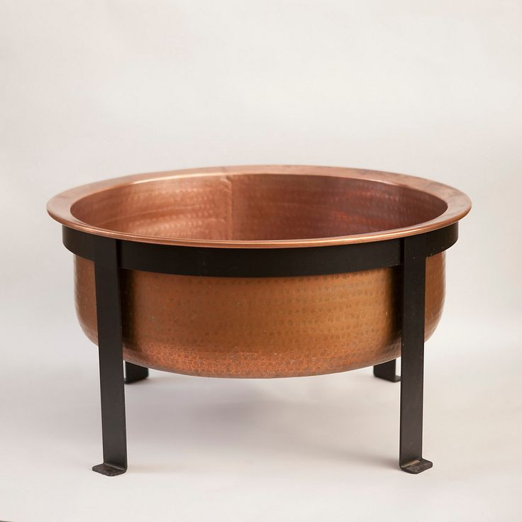 """Hand-crafted in Turkey especially for terrain, this copper fire pit is the patio's best multi-tasker. Perfect for holding a crackling flame, it can also serve as a grill, serving piece, or outdoor table thanks to a tray cover with built-in handles and a removable, steel interior grate.- A terrain exclusive- Solid copper, powder coated steel- May patina over time; use copper care products to restore natural luster- Tray: 2""""H, 32.9"""" diameter- Handmade in Turkey16.9""""H, 32.9"""" diameterOrder by…"""