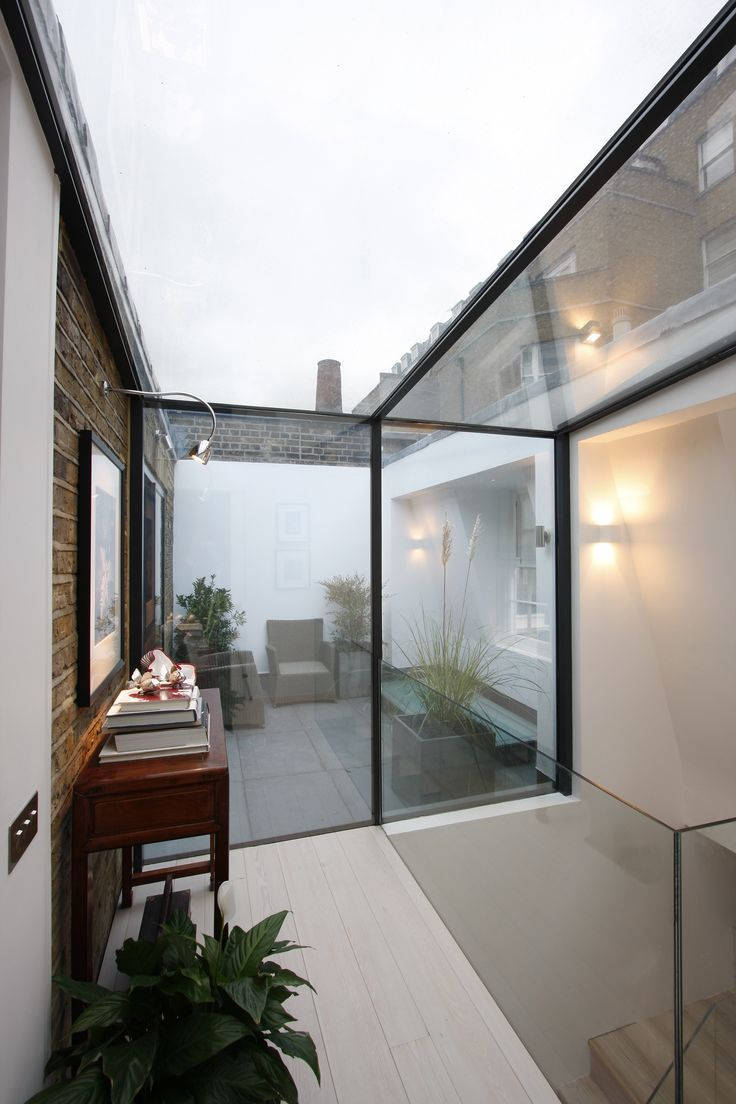 Structural Glass wall connecting to glass roof by IQ Glass