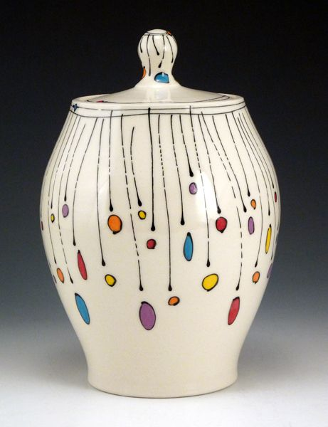 Matt Wilson and Emily Free Wilson are the dynamic duo that is Free Ceramics.    Free Ceramics is a family run pottery in Helena, Montana where a team of artists work together to create whimsical pottery that will always bring a smile to your face.  Inspired by the designs of Emily Free Wilson.