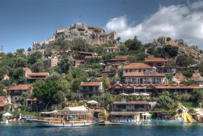 Simena (Kalekoy) Turkey is a popular village on Mediterranean cruises. Well known for its homemade icecream flavours, another reason to visit is the view of Kekova Bay from the Byzantine castle.