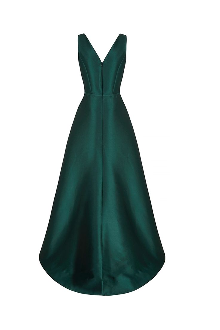 The V-Curve dress is a long glamorous gown with a modern appeal. Tailored from the most divine silk acetate blend woven Italian cloth in Bottle Green. The dress has a softly structured appeal, a wonderfully flattering modern cut and a striking timeless presence. The neckline is a gently curved v shape with fitted bodice seams and a high pitched waistline. x
