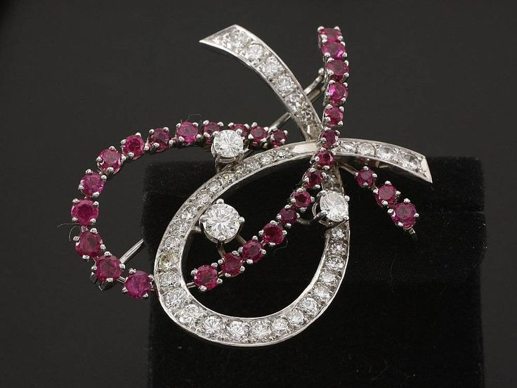 Gold brooch with Diamonds and Rubies 5,40 ct by ARTaVIP on Etsy https://www.etsy.com/listing/529576771/gold-brooch-with-diamonds-and-rubies-540