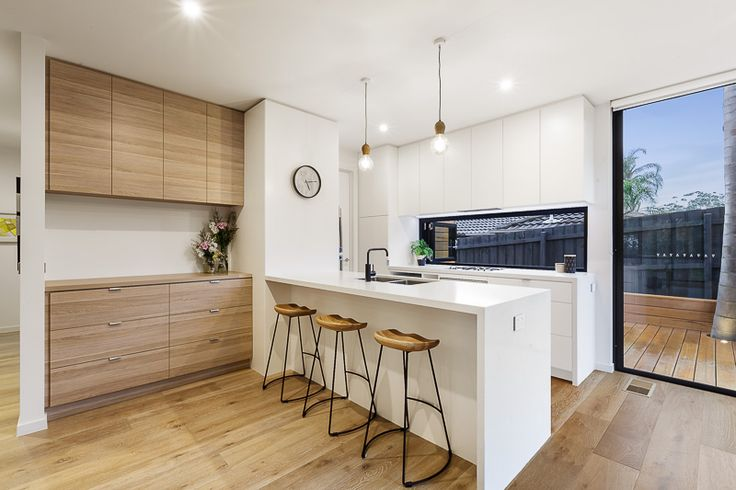 Black Rock - Project by Chisholm Constructions - Modern kitchen design with clean lines and a neutral colour palette featuring Natural Oak Ravine and Classic White Matt