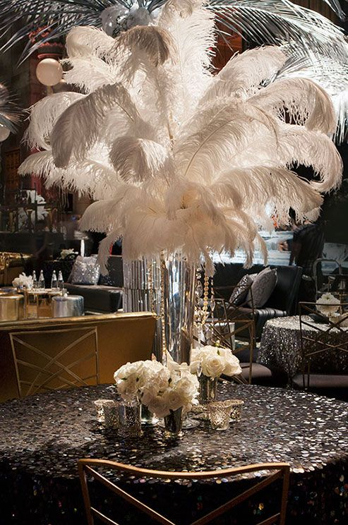 This Great Gatsby inspired tabletop is featuring white feather centerpiece and sparkle black linens. #weddingcenterpiece