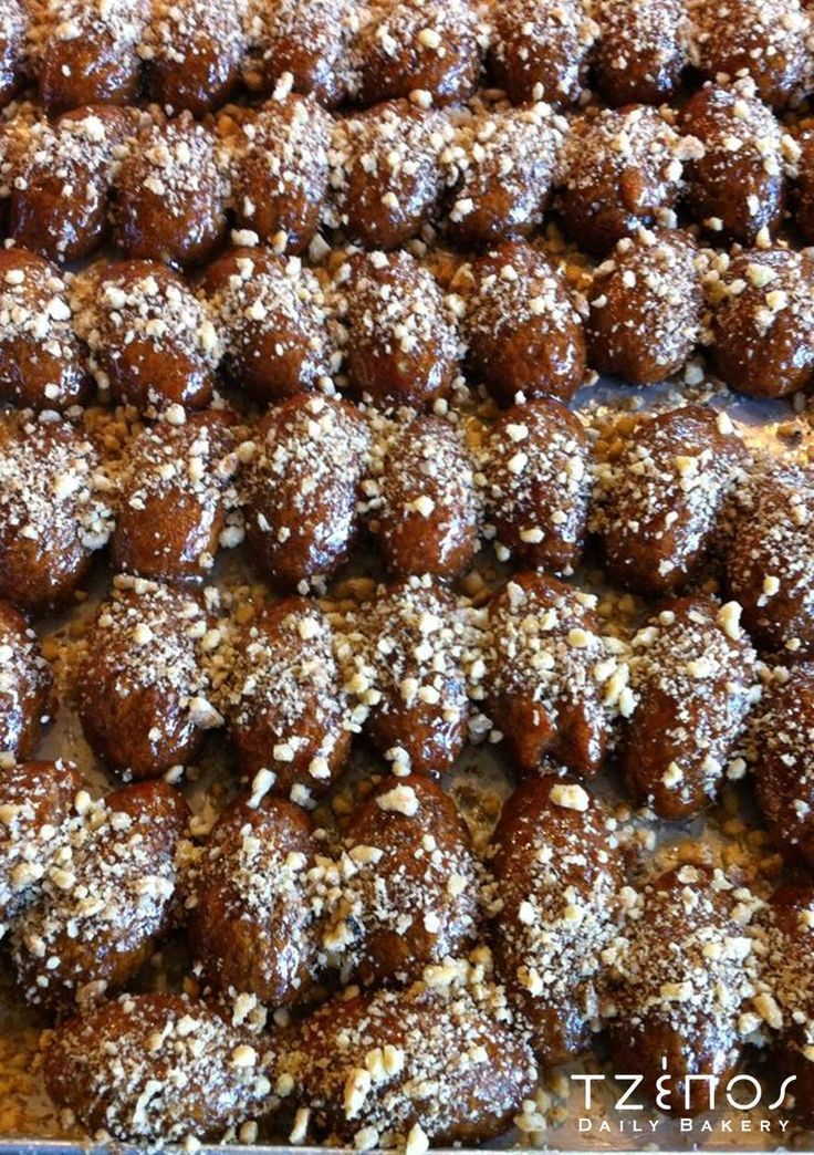 Melomakarona - Cinnamon biscuits dipped in honey syrup and sprinkled with chopped walnuts