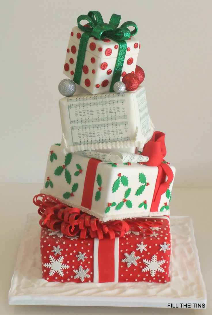 "https://flic.kr/p/cFreA9 | Mid Winter Xmas/Birthday Cake | 4 tier topsy turvy cake, bottom tier 12"" carrot cake, 10"" lemon cake and the top two tiers are dummy cakes."