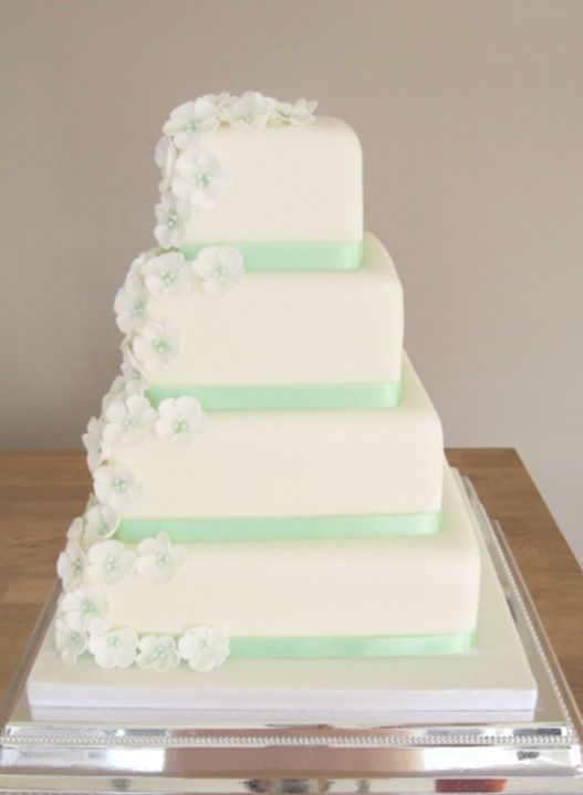 White & mint wedding cake. Simple but still classy with a hint of your wedding colour.