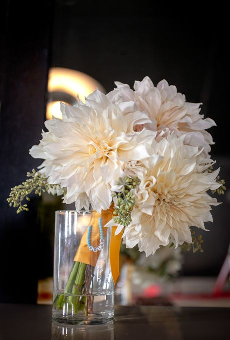 Brides: White Dahlia Bouquet. For a non-traditional twist on the classic all-white bouquet, consider an unlikely bloom. New York City-based florist Opalia Florals uses large white dahlias to complement a modern bride's aesthetic.