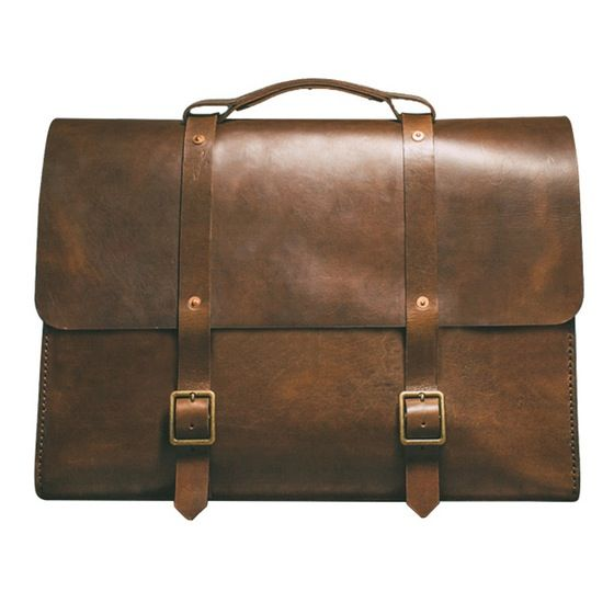 Story  Inspired by a Map Case from WWII, Satchel & Page bags are meant to be passed down to future generations. FEATURES  Lifetime warranty Handstitched seams for durability and aesthetics Interior compartment for laptop Pocket for iPhone/Droid Slots for pens and business cards Oil finished edges Copper rivets and antique brass hardware Adjustable leather shoulder strap (up to 55 inches)  Materials   8oz Rich brown, vegetable tanned leather Hot stuffed with oils and waxes for a unique, r...