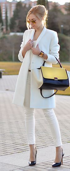 Nothing spells winter like white. Absolutely adoring this white on white look. White ankle grazer skinny jeans, white tailored coat. To add some girl it has been paired with a yellow and black block colour tote and black pointy heels.