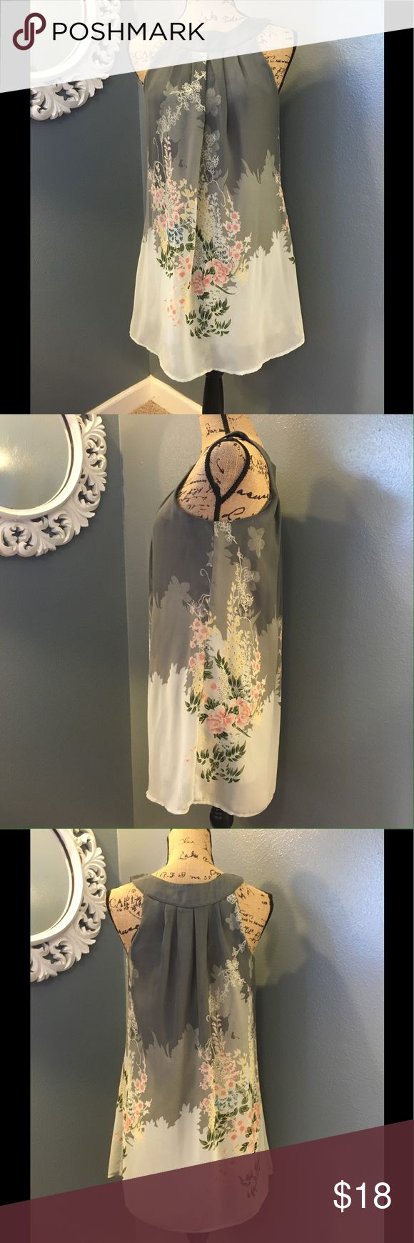 """XXI ethereal gray flower print tunic top or dress Sleeveless gray and cream colors. Loose fitting and gauzy flowing fabric with light scattering of blossoms. It is fully lined. The length gives some versatility in styling with sandals as a dress or with leggings. Pull on, no closures. Excellent condition, 31"""" in length. XXI Dresses"""