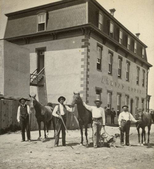 Group photo outside Armijo House Hotel, Albuquerque, New Mexico, including a man supposedly holding Billy the Kid's horse Photographer: Ben Wittick Date: 1881 Negative Number 086863