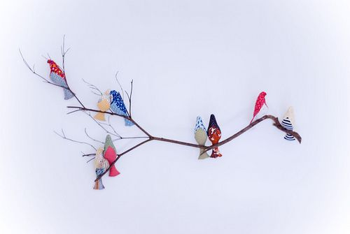 """fabric birds   """"I used the free bird softie pattern from Spool, scrap fabric, and a branch from our backyard. The birds are kept in place by that demi-god of the crafting world, hot glue. The branch is hung from the molding with near-invisible fishing wire."""""""