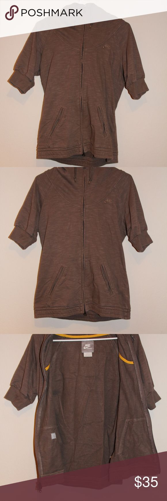 Nike Brown Beige Zip Up Hoodie Sweatshirt Rare style Brownish Beige color Nike Zip up Sweatshirt Size Medium 8 short sleeve with Waist pockets. Sweatshirt is in excellent condition with a hood and has no rips stains marks or tears anywhere. Nike Tops Sweatshirts & Hoodies