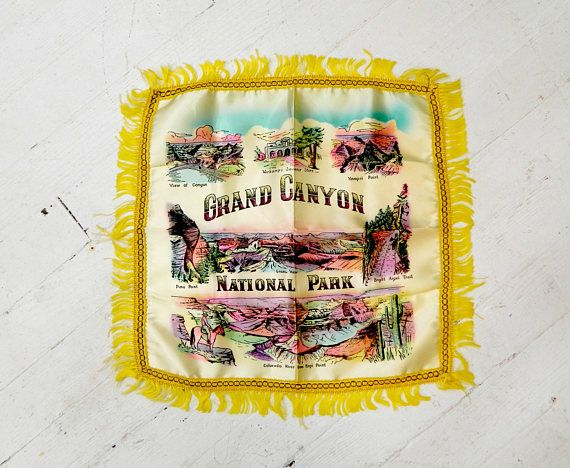 ~ this is a 1940s screen print satin souvenir pillowcase from the Grand Canyon National Park ~this pillowcase features drawn depictions of Yavapai Point, Bright Angel Trail, the Colorado River from Hopi Point, Pima Point, a View of the Canyon, and Verkamps Souvenir Store. With a