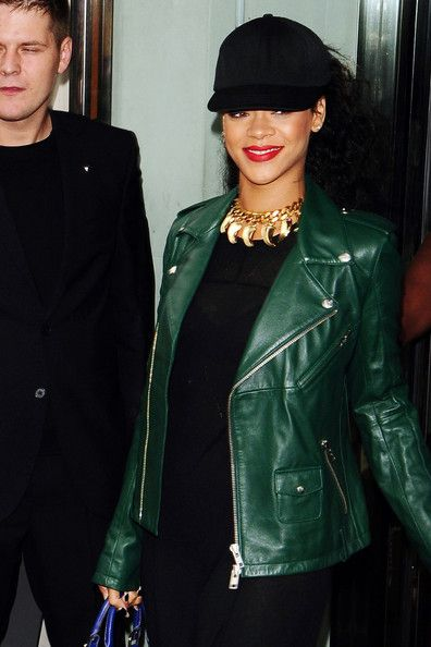 Rihanna Photo - Rihanna in Green Leather. Rihanna sneaks a smile as she leaves her hotel in London wearing a hunter green leather jacket. #Rihanna