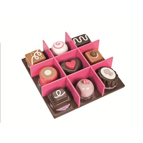 An exquisitely packaged gift box with a heart motif containing 9 assorted wooden toy chocolates.  The chocolates fasten to the wooden tray for portable play.  3+ assembled
