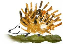 Image of a hedgehog with handprints and leaves