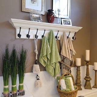 Beige green bathroom Love the shelf with hooks...