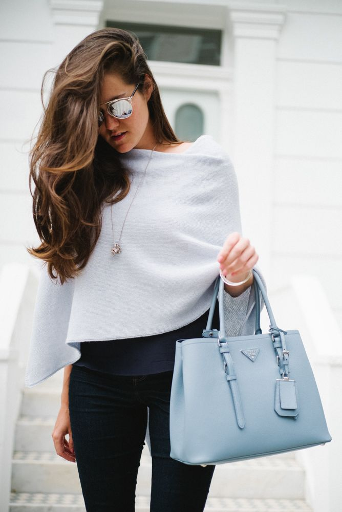 West Thirty Six - The Londoner | Shades of blue: navy blue camisole, light blue assymetric cashmere poncho jumper shrug, skinny jeans, suede heels, powder blue tote bag and silver jewellery #spring