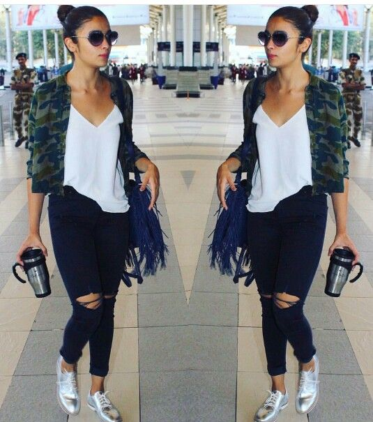 Alia Bhatt wearing casual ripped jeans with white top and camouflage printed shirt at the airport.