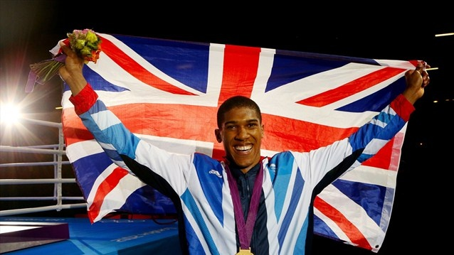 Gold medallist Anthony Joshua of Great Britain celebrates  Gold medallist Anthony Joshua of Great Britain celebrates after the Victory Ceremony for the men's Super Heavy (+91kg) Boxing final bout on Day 16.