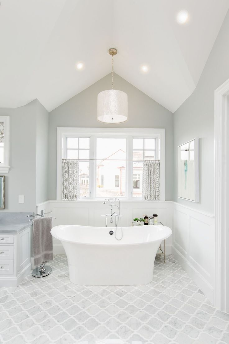 The master bathroom features a classic grey and white color scheme. Paint color is, once again, Benjamin Moore Stonington Grey .  Freestanding tub is Victoria & Albert Toulouse Free Standing Tub.