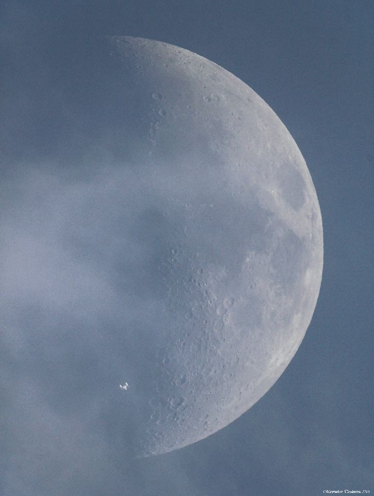 International Space Station (ISS) in transit over the moon - photo taken June 15, 2013, in plain daylight, with the Sun 26 degrees above the horizon.