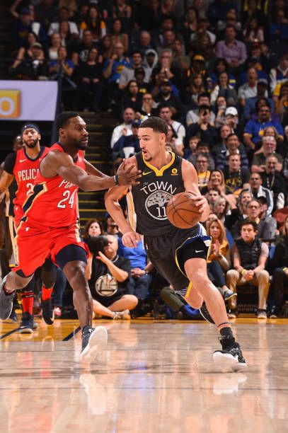 Klay Thompson of the Golden State Warriors handles the ball against the New Orleans Pelicans on November 25 2017 at ORACLE Arena in Oakland...