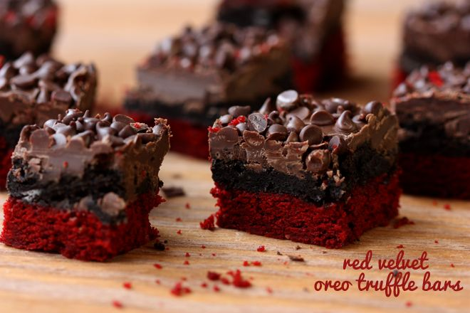 Valentine's Day Red Velvet Oreo Truffle Brownie Bars!  A layer of red velvet brownies with an Oreo truffle layer topped with chocolate and mini chocolate chips. Yes, Oreo truffle! As in, the filling in addictive Oreo truffles spread out across red velvet brownies. Sinful. Sultry. Perfect.