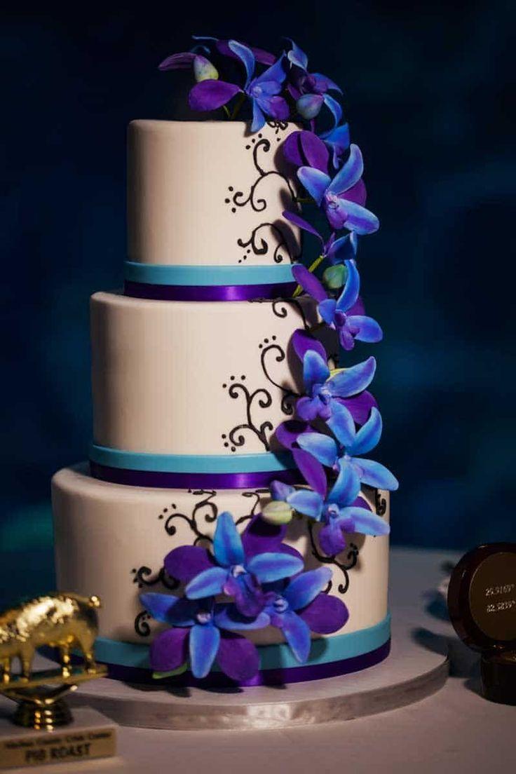 Blue and Purple Wedding Cake by Hands on Sweets - Blue and Purple Florida Aquarium Wedding - Tampa Wedding Venue - Photo: Limelight Photography - Orange Blossom Bride - www.orangeblossombride.com - click pin for more