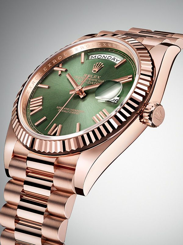 The Rolex Day-Date 40 anniversary edition in Everose gold with a green dial, fluted bezel and President bracelet.