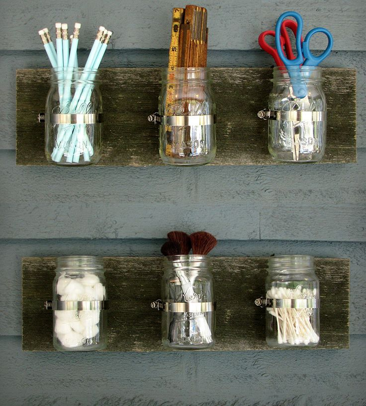 The three mason jars in each wall organizer can hold just about anything, from toothbrushes to pens to spoons, flowers and candles. Just han...
