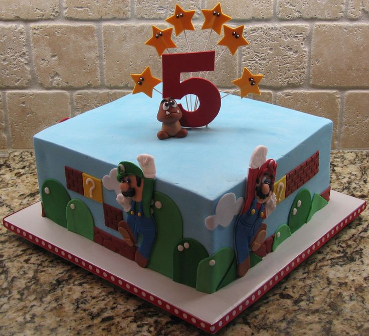 """Super Mario Brothers - This cake was done in buttercream with fondant accents.  All the accents with the exception of the """"5"""" are done in fondant.  The """"5"""" was done in gumpaste."""