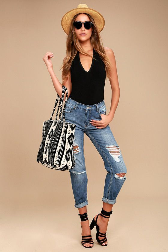 Make all the boys jealous in the Billabong Hey Boy Medium Wash Distressed Boyfriend Jeans! These slouchy, mid-rise jeans have fading and distressing throughout, plus a five-pocket cut, belt loops, top button, and hidden zip. Relaxed, tapered legs. Logo tag at back.