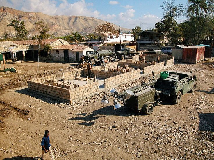 U.S.Navy Seabees assigned to Naval Construction Battalion One (NMCB-1), construct a new school in Gonaives, Haiti in 2004.