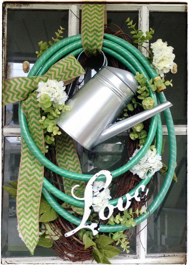 Beautiful Garden inspired Garden Hose Wreath.