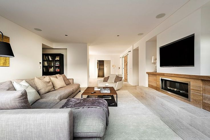 Ozone Residence by Swell Homes - Television built in.  This might work if there is an entry at the back of the wall where the TV can be slid in and out.