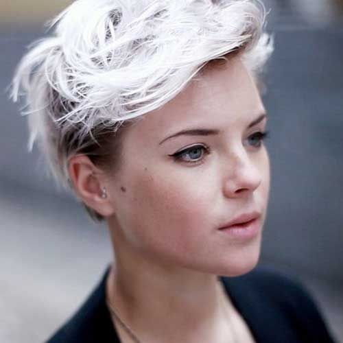 Platinum blonde hair - dark undercut sides add dimension to this style by contrasting with the longer platinum hair...