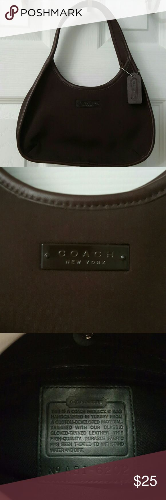 Coach brown handbag This coach handbag is a dark brown neoprene material. Hangtag included  No stains inside or outside. Nonsmoking home. Coach Bags Mini Bags