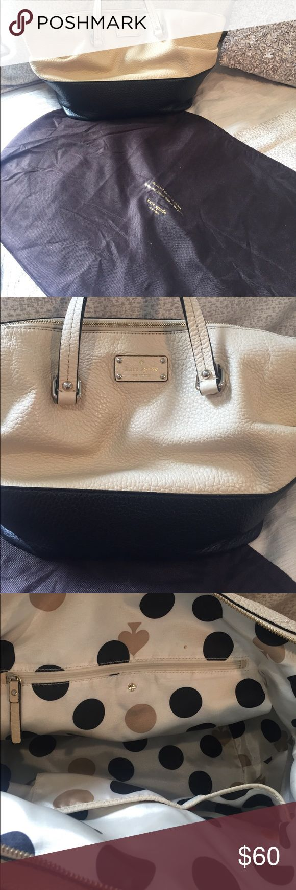 Kate Spade pebble leather bag Kate Spade Black and Tan pebble leather bag, gently used, make up and pen stains on interior, dust bag included kate spade Bags Shoulder Bags