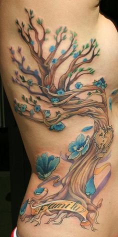 Knots with SZ and AA in tree with trunk branching out under girls tattoo