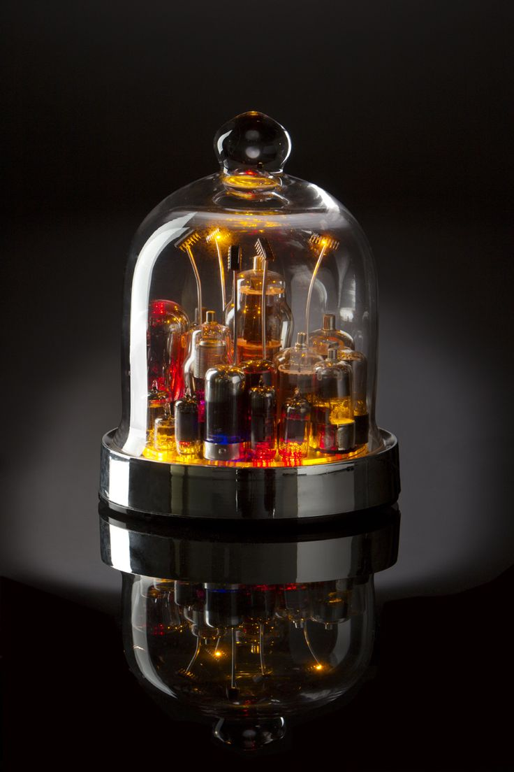 """The rainbow is framed in chrome and mirrors and captured under a single glass dome. Our classic design is equally enticing as an accent piece on shelf, desk, or table. Beneath the glass sits a generous portion of hand-selected glowing antique vacuum tubes which sit displayed under sparking """"chip-lights."""" In this scene of frozen vibrancy lies the world of yesterday's imagination with the technology of tomorrow. $700. Check out more amazing tech gift vacuum tube art at creationsbybaloopas.com."""